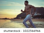 fitness athlete man posing on... | Shutterstock . vector #1022566966