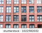 pattern of brick glass window... | Shutterstock . vector #1022582032