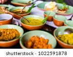 variety of sri lankan curry in... | Shutterstock . vector #1022591878