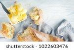 butter on a fresh crunchy...   Shutterstock . vector #1022603476