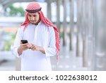 arab business use mobile phone... | Shutterstock . vector #1022638012