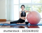 woman play ball yoga in fitness. | Shutterstock . vector #1022638102