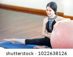 woman play ball yoga in fitness. | Shutterstock . vector #1022638126