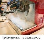 coffee machine release hot... | Shutterstock . vector #1022638972