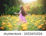 little asian girl in flower... | Shutterstock . vector #1022651026