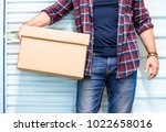 young man holding a moving...   Shutterstock . vector #1022658016