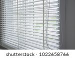 white curtain or wooden blinds... | Shutterstock . vector #1022658766