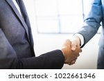 businessman shaking hands to... | Shutterstock . vector #1022661346