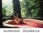woman and man relaxing in bath... | Shutterstock . vector #1022666116