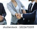 closeup.the handshake business... | Shutterstock . vector #1022673205