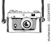 retro cinema video camera with... | Shutterstock .eps vector #1022693455