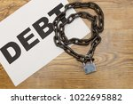 chain with word debt. concept... | Shutterstock . vector #1022695882
