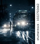 Stock photo toronto streetcar at night winter snow storm with man getting off public transit train vehicle 1022702662