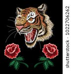 tiger face with roses  floral... | Shutterstock .eps vector #1022706262