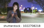 asian young woman use of smart...   Shutterstock . vector #1022708218