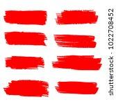 set of hand painted red brush... | Shutterstock .eps vector #1022708452