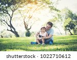 father and daughter smiling... | Shutterstock . vector #1022710612