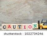 toy forklift hold letter block... | Shutterstock . vector #1022734246