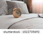 wooden modern alarm clock on... | Shutterstock . vector #1022735692