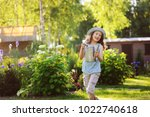 happy funny child girl in...   Shutterstock . vector #1022740618