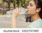 women are drinking cool water... | Shutterstock . vector #1022747485