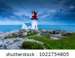historic red white lighthouse... | Shutterstock . vector #1022754805