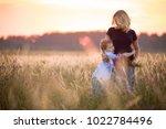 cute kid boy hugging his mother ... | Shutterstock . vector #1022784496