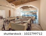 restaurant interior in a new... | Shutterstock . vector #1022799712