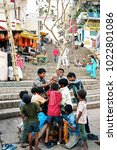 Small photo of Varanasi, India - october,20,2014: Unidentified young boys install a tree for the ceremony of Ganga Aarti