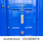 a blue door. | Shutterstock . vector #1022808076