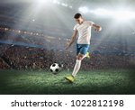 soccer player on a football... | Shutterstock . vector #1022812198