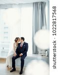 groom and bride posing and... | Shutterstock . vector #1022817568