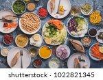 vegan veggies meals on dinning... | Shutterstock . vector #1022821345