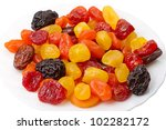 Heap dried fruit (prunes, apricots, figs, dogwood, date) on a white plate - stock photo