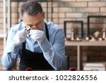 jeweler working in workshop | Shutterstock . vector #1022826556