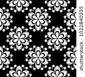 white floral ornament on black... | Shutterstock .eps vector #1022840335