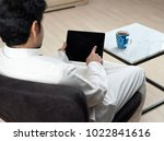 saudi arabian man using tablet... | Shutterstock . vector #1022841616