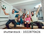 happy friends or football fans... | Shutterstock . vector #1022870626