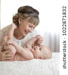 happy family mom and kid.... | Shutterstock . vector #1022871832