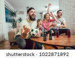 happy friends or football fans... | Shutterstock . vector #1022871892