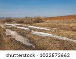 spring landscape. the last snow ... | Shutterstock . vector #1022873662