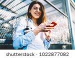 smiling female student in... | Shutterstock . vector #1022877082