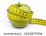 apple and tape measure  ... | Shutterstock . vector #1022879506
