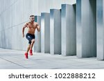handsome shirtless athlete... | Shutterstock . vector #1022888212