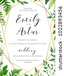 Natural botanical wedding invitation, invite, save the date template. Vector floral design card. Green fern forest plant leaves & herbs greenery mix.  Geometrical golden frame, border with copy space. | Shutterstock vector #1022893456