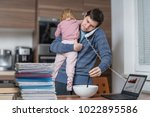 multitasking father is... | Shutterstock . vector #1022895586