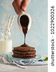chocolate pancakes with... | Shutterstock . vector #1022900326