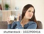 woman refusing a glass of milk... | Shutterstock . vector #1022900416