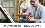 male art school artist painting ... | Shutterstock . vector #1022901958