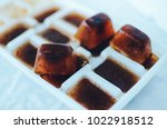 ice cubes made with coffee in... | Shutterstock . vector #1022918512